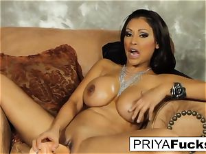 Priya satisfies her hunger with a plaything