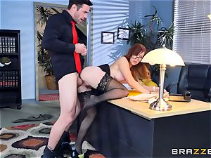 Dani Jensen playing with knob in the office