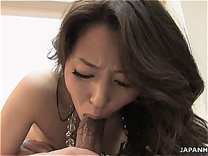 japanese satiates her fur covered fuck-hole and deep throats her man's trunk
