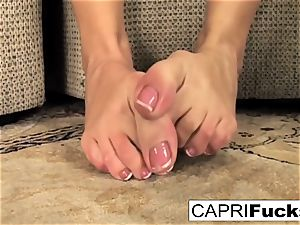 Capri plays with her gash and feet