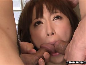 splashing asian is strapped up and used in a three-way