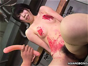 chinese super-bitch enjoys to be bdsm handled to a wax flash