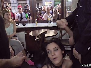 dark haired gets facial in public bar