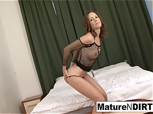 brown-haired milf strokes before taking a big black cock