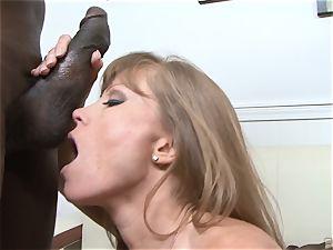 Darla Crane pulverizes dark-hued man meat before her husband cleans up