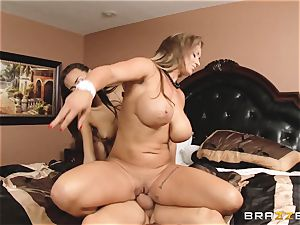 Eva Notty displays her stepdaughter Janice Griffith how to sate a spear